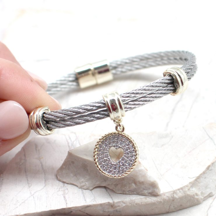 A photo of the Heart Cutout Magnetic Bangle product