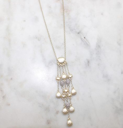 A photo of the Matte Gold Drops Necklace product