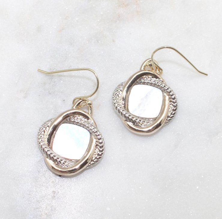 A photo of the Pearly Dangle Earrings product