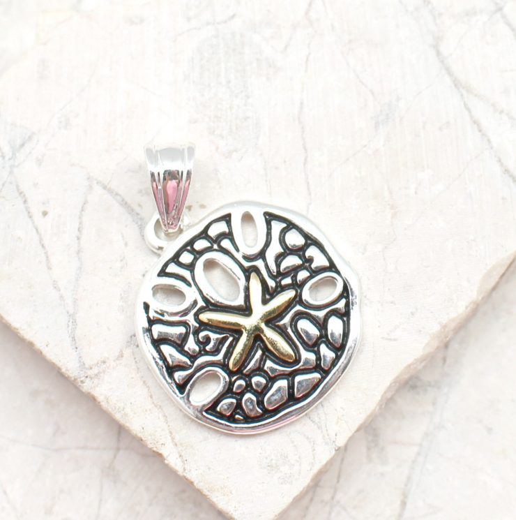 A photo of the Small Sand Dollar Pendant product