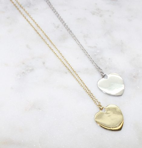 A photo of the Heart Strings Necklace product