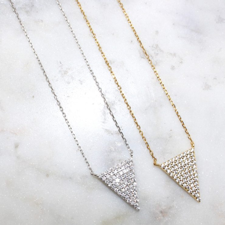 A photo of the Point This Way Necklace product