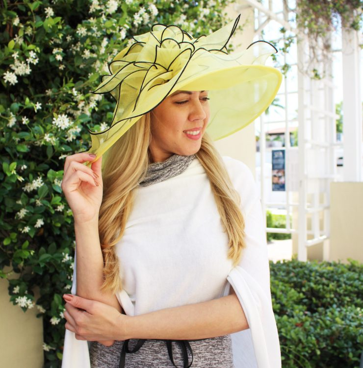 A photo of the Black and Yellow Fascinator Hat product