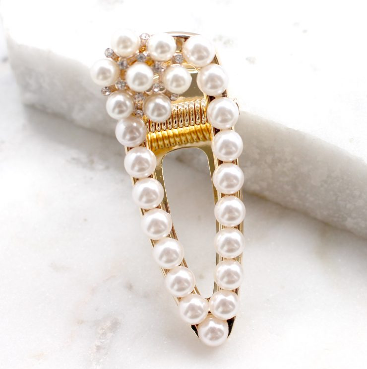 A photo of the Pearl Floral Clamp Clip product