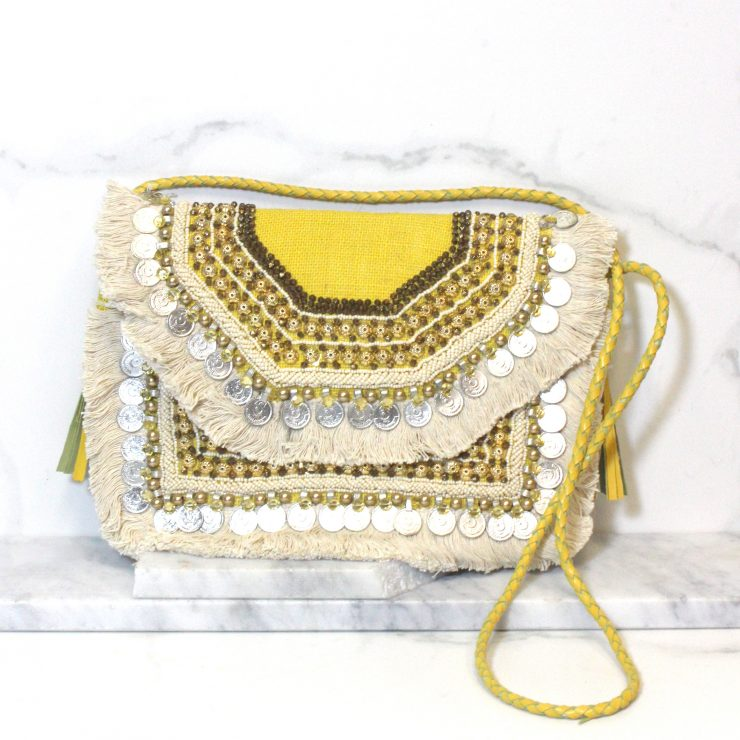 A photo of the Coined It Clutch product