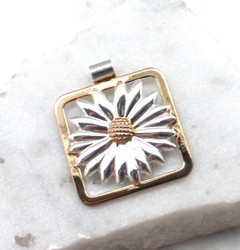 A photo of the Daisy Portrait Pendant product