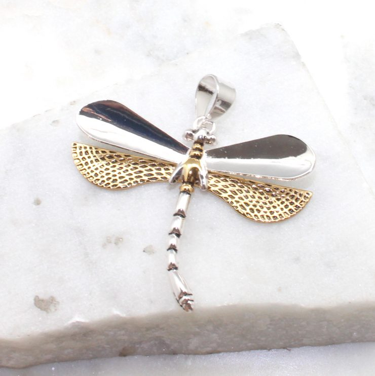 A photo of the Textured Dragonfly Pendant product