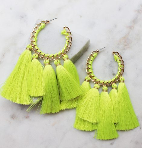A photo of the Truly Neon Tassel Earrings product