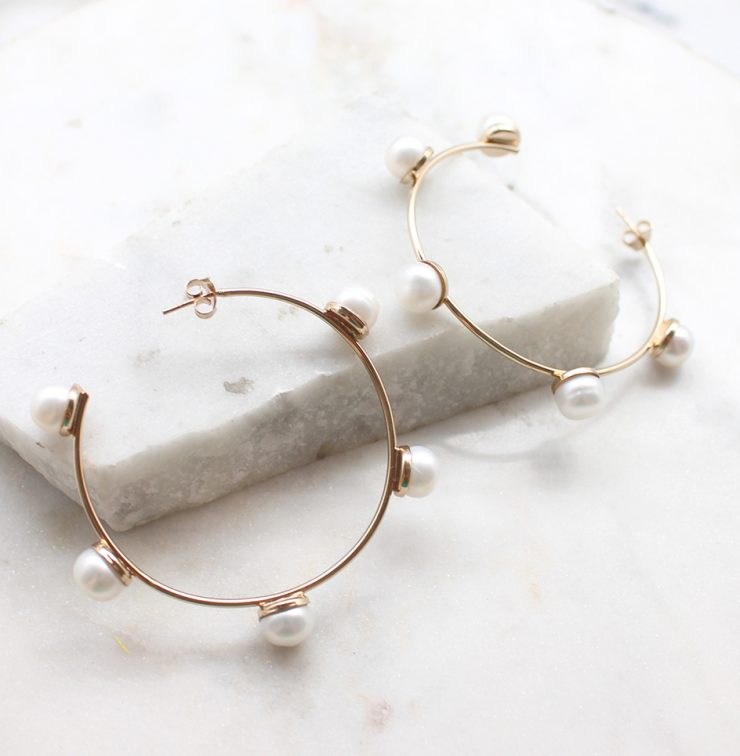 A photo of the Glimmer Hoop Earrings product
