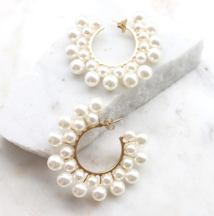 A photo of the Sheen Earrings product