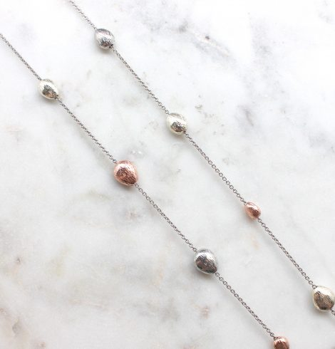 A photo of the Tri Tone Pieces Necklace product
