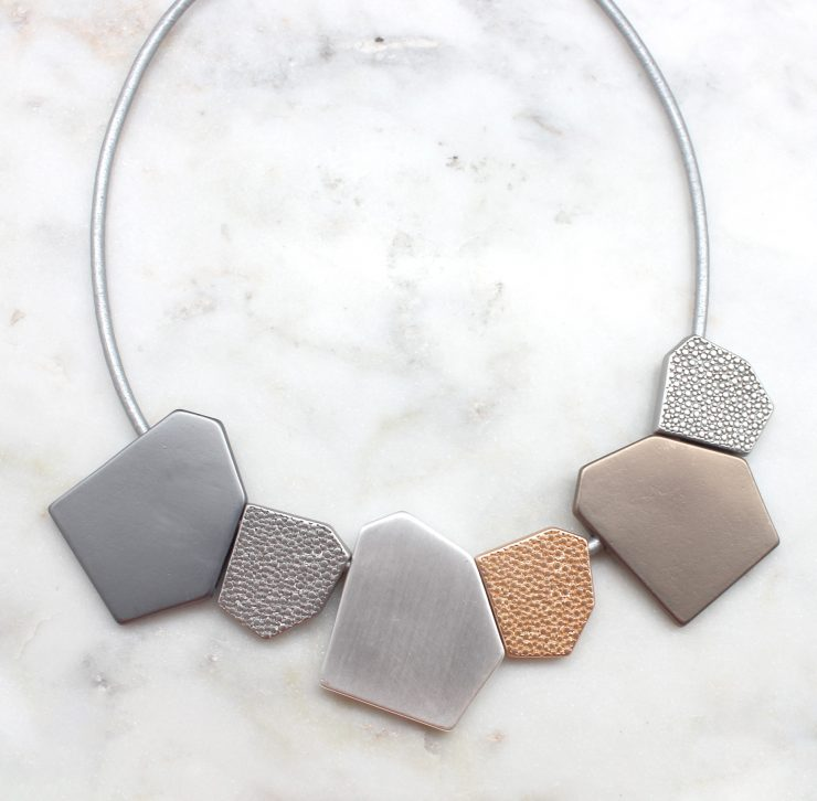 A photo of the Jagged Pieces Necklace product