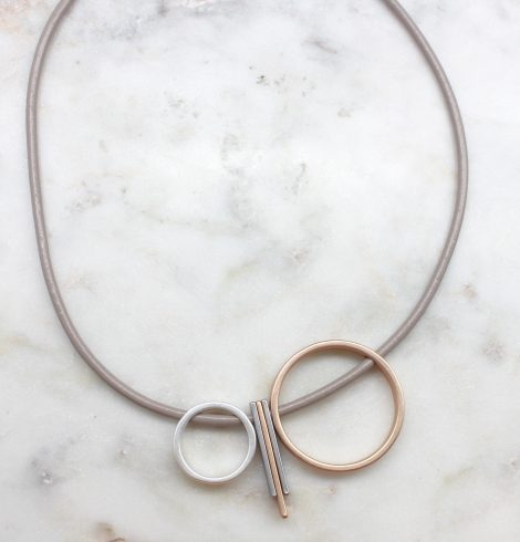 A photo of the Round Pieces Necklace product