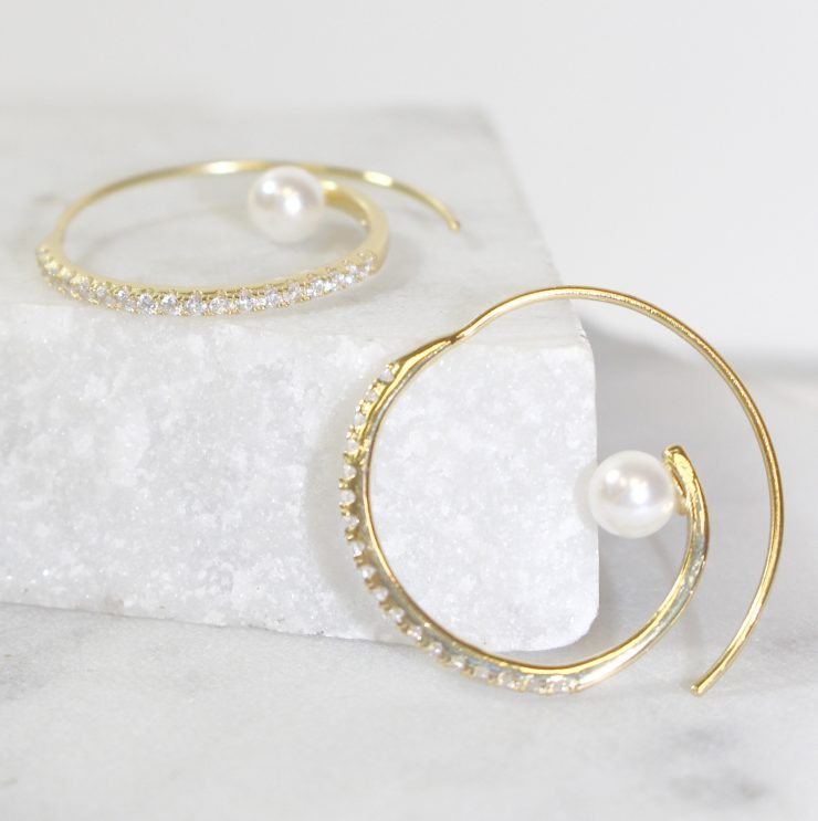 A photo of the Swirl Pearl Hoops product