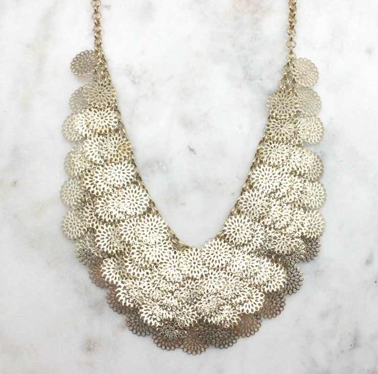 A photo of the Cutout Coins Necklace product