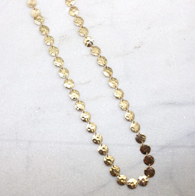 A photo of the Hammered Disc Necklace product