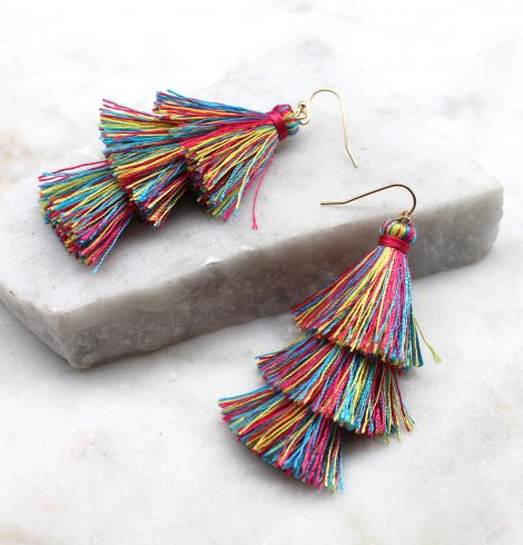 A photo of the Tiered Tassel Earrings product