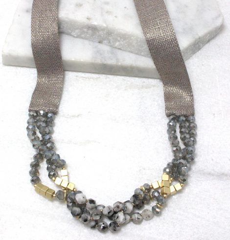 A photo of the Beaded Ribbon Necklace in Grey product