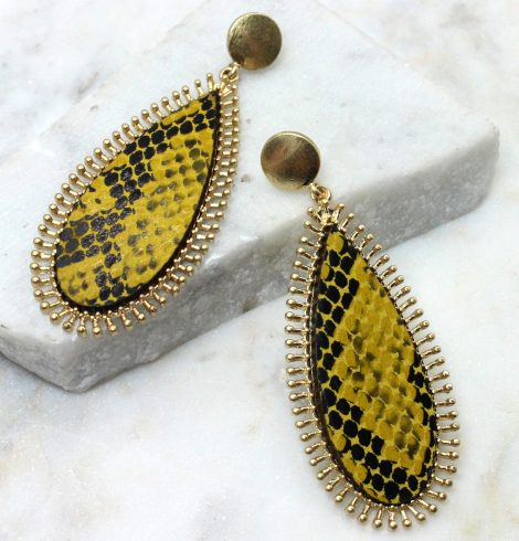 A photo of the Wild Bound Snake Print Earrings product