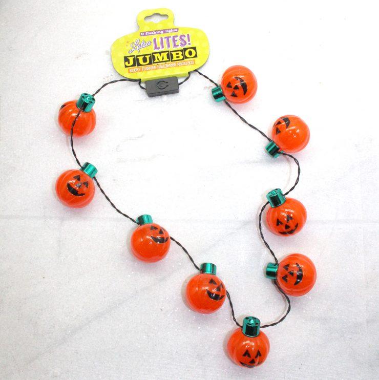 A photo of the Light Up Jack-O-Lantern Necklace product