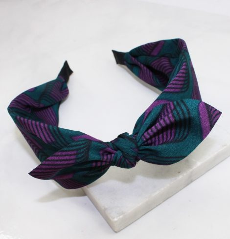 A photo of the Forest Green & Purple Swirl Headband product