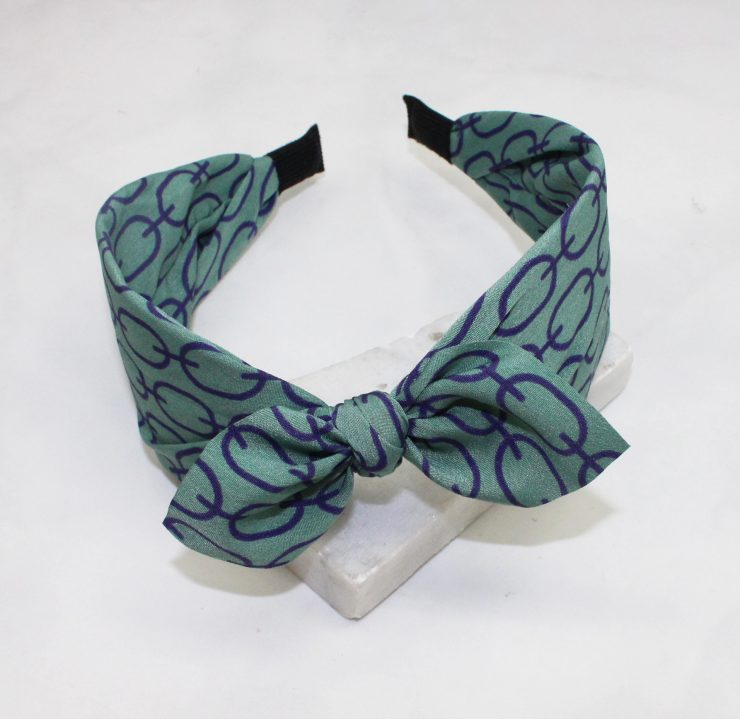 A photo of the Green & Purple Link Headband product