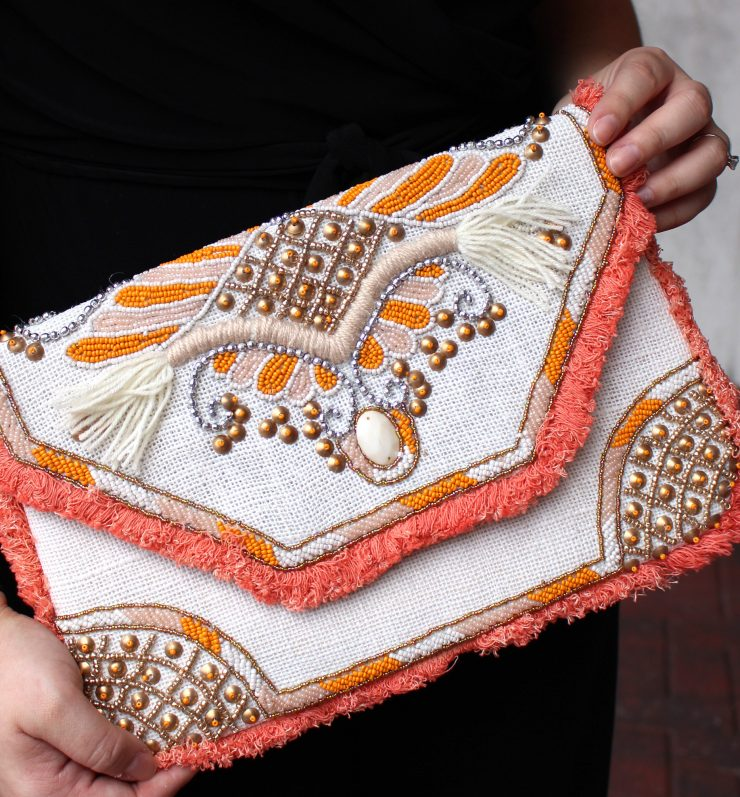 A photo of the Just Peachy Clutch product