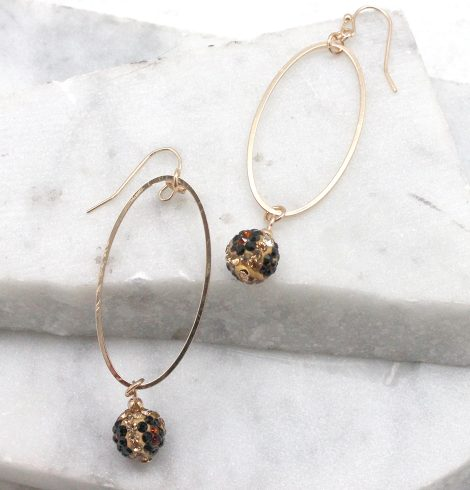A photo of the Fireball Leopard Dangle Earrings product