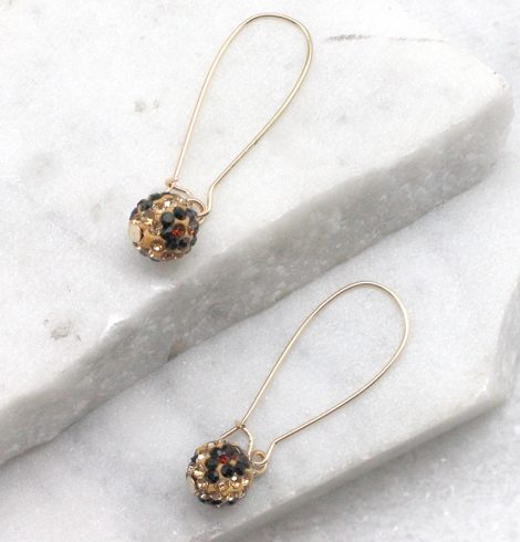 A photo of the Fireball Leopard Wire Earrings product