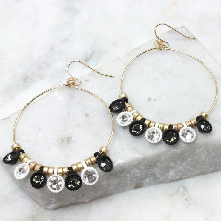 A photo of the Lost In Love Black and White Earrings product