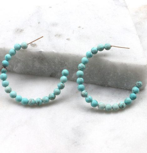 A photo of the Matte Beaded Hoops product