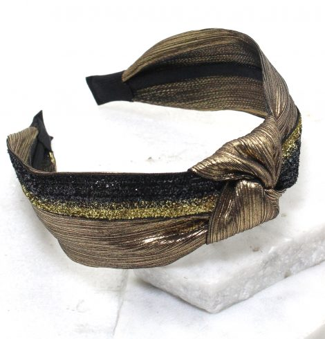 A photo of the Metallic Made Headband in Silver product
