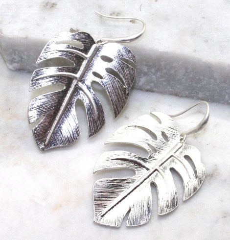A photo of the Monstera Leaf Earrings product