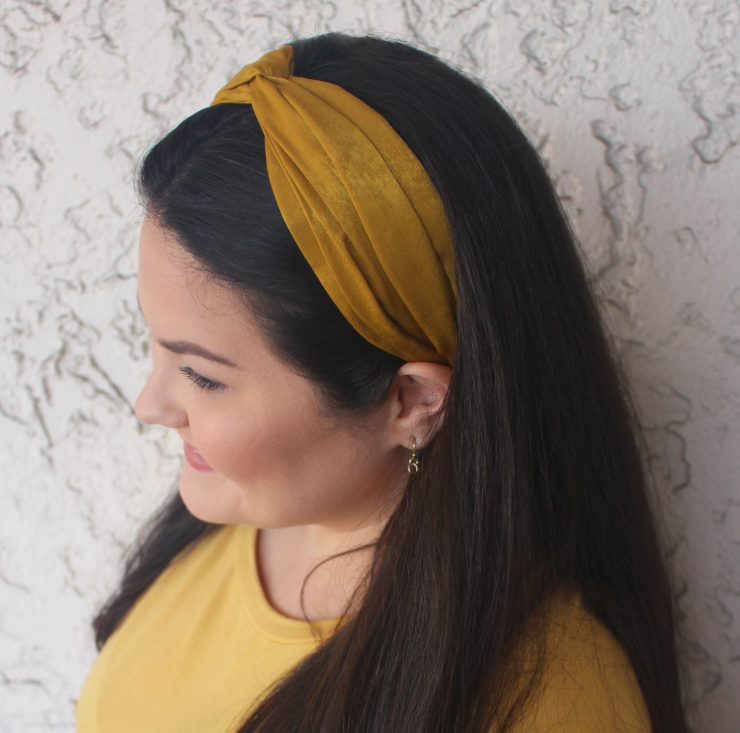 A photo of the Mustard Twist Headband product