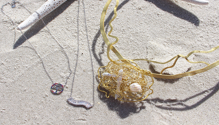 Photo of necklaces in the sand