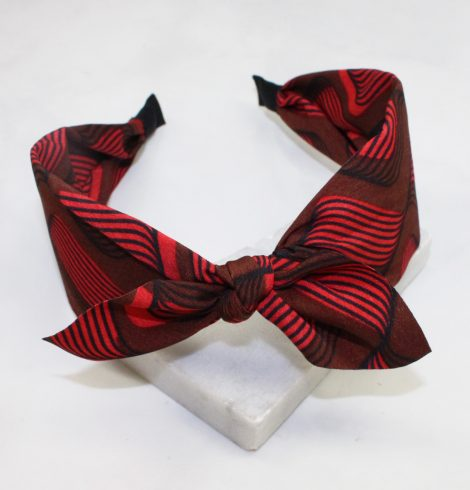 A photo of the Red & Brown Swirl Headband product