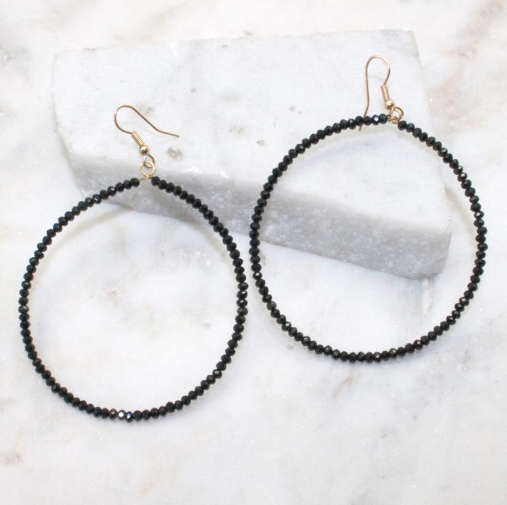 A photo of the Large and Small Round The Way Earrings product