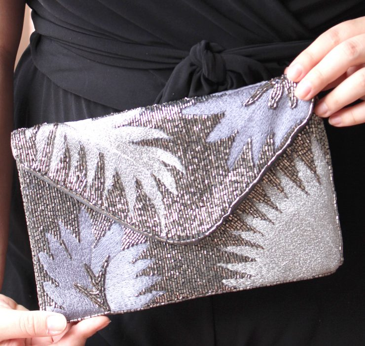 A photo of the Silver Palm Clutch product