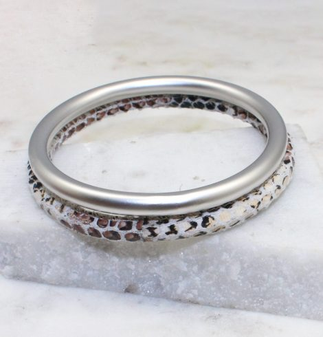 A photo of the Slithering Through Bangle Set In White product
