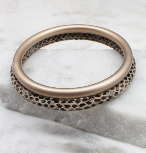 A photo of the Slithering Through Bangle Set In Brown product