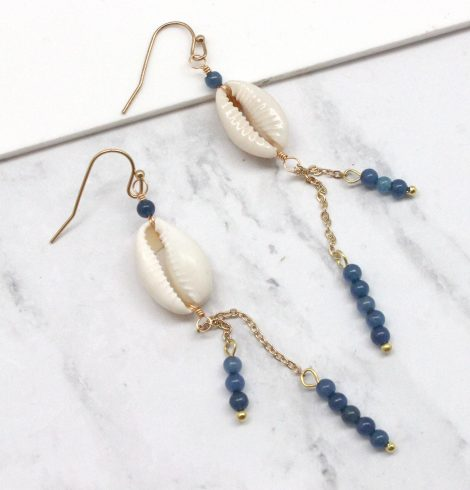A photo of the Beaded Cowrie Earrings in Blue product