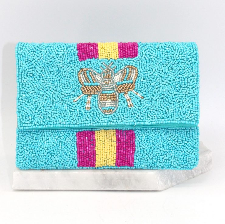 A photo of the Bee Beautiful Mini Clutch in Blue product