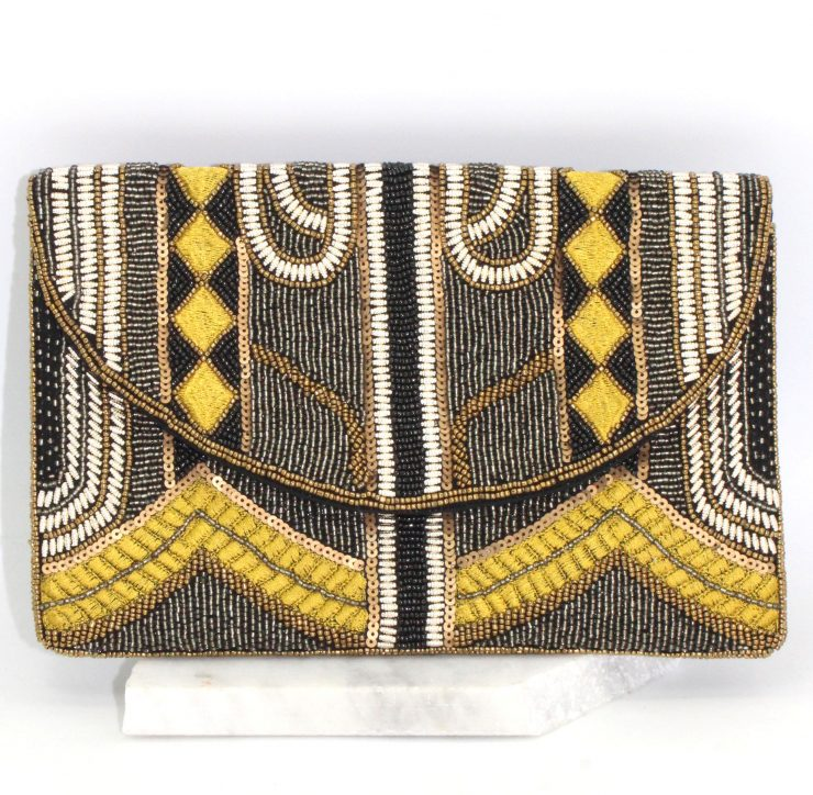 A photo of the Black and Yellow Beaded Clutch product