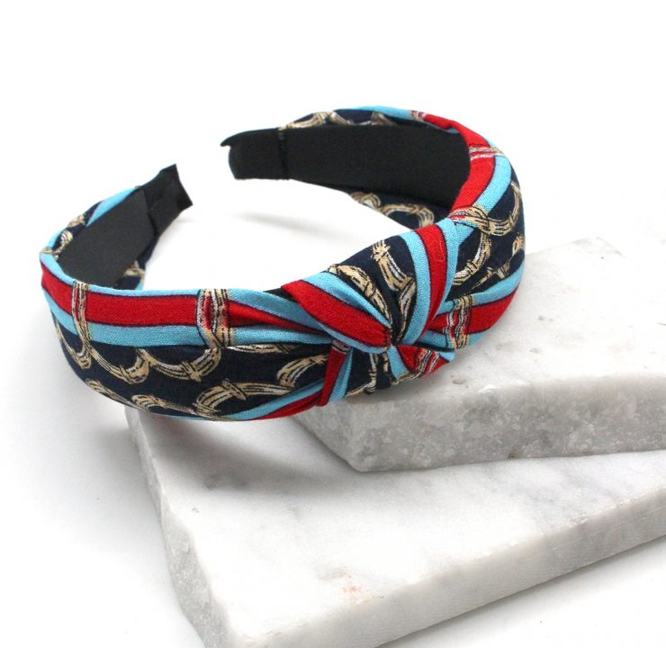 A photo of the Chains and Stripes Headband in White product