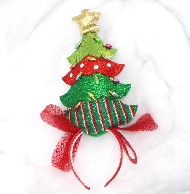 A photo of the Christmas Tree Head Band product