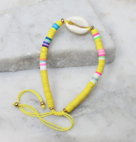 A photo of the Cowrie Shell Adjustable Bracelet In Yellow product