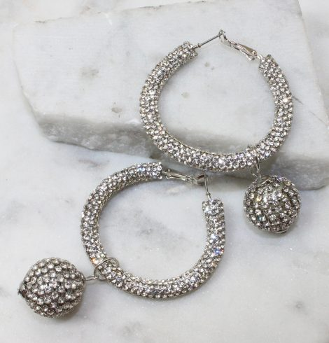 A photo of the Disco Hoop Earrings In Clear product