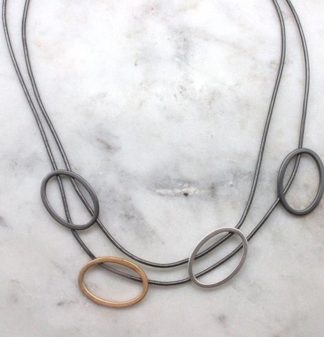 A photo of the Double Tri Tone Necklace product