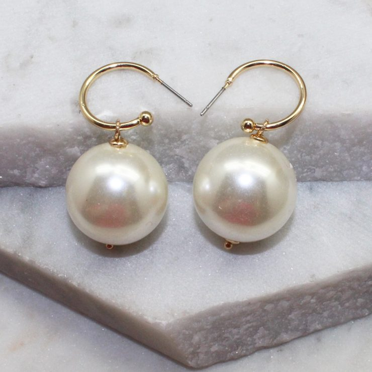 A photo of the Keep The Class Earrings In Gold product