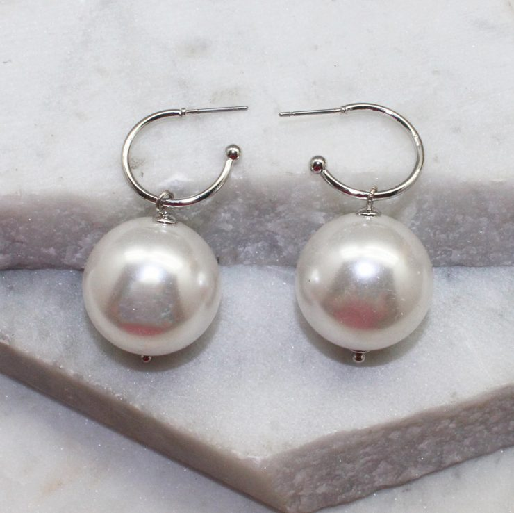 A photo of the Keep The Class Earrings In Silver product